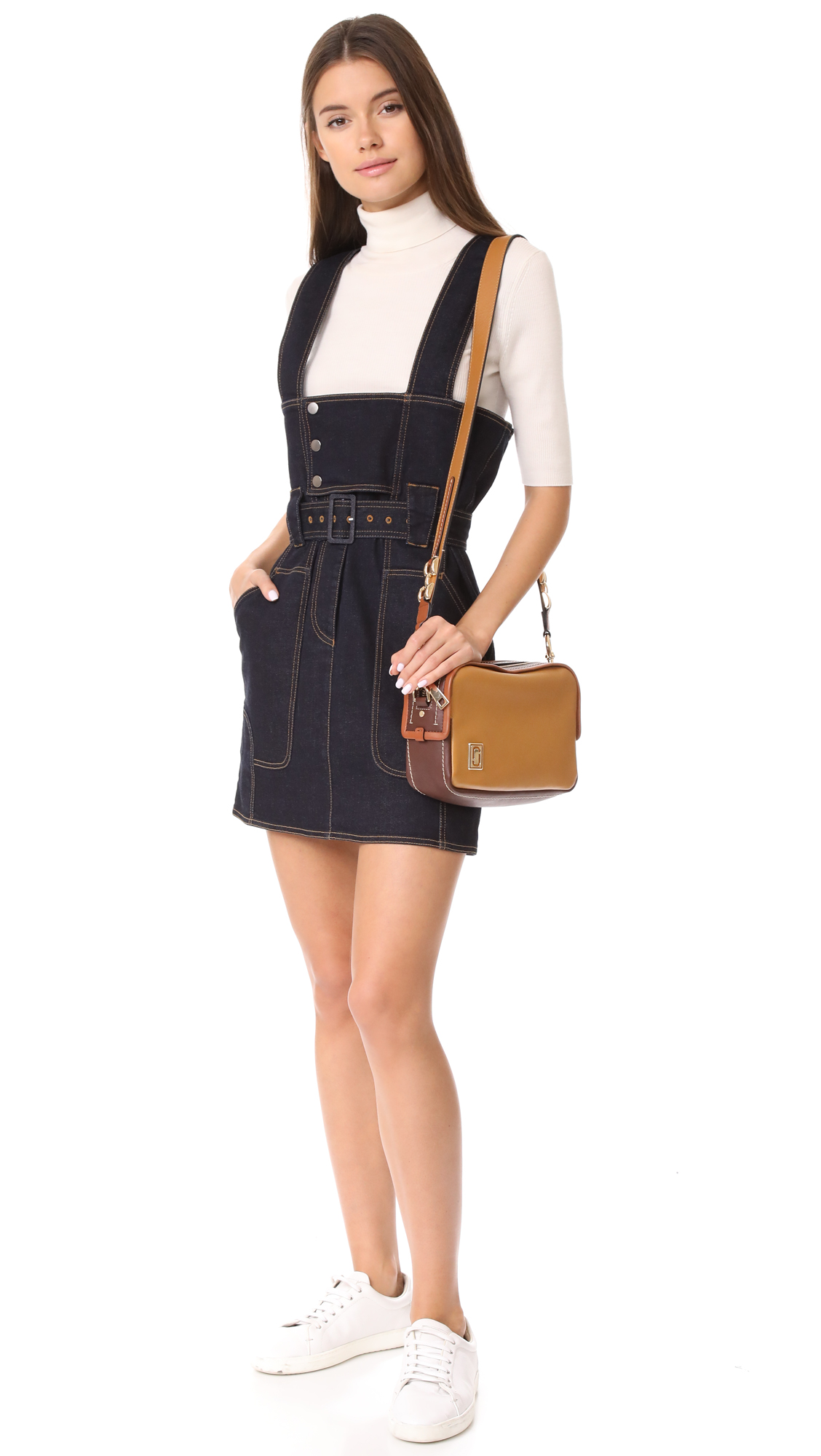 078bf60185 The top zip opens to a lined interior with 2 pockets. Adjustable shoulder  strap. Dust bag included.Leather  Cowhide.Weight  20oz   0.57kg.Imported
